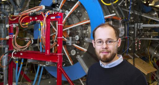 Physicist Will Fox with Magnetic Reconnection Experiment.